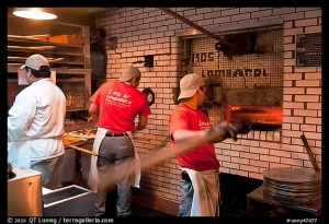 Pizza preparation, Lombardi pizzeria kitchen. NYC, New York, USA